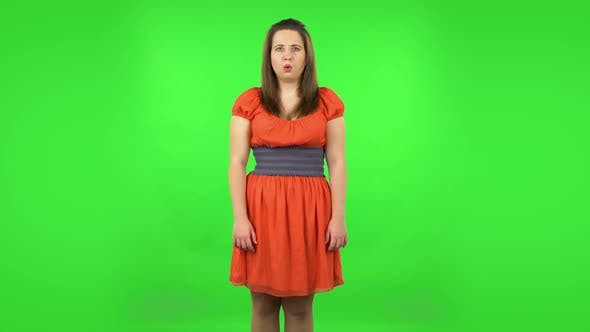 Thumbnail for Frustrated Girl Says Wow with Shocked Facial Expression. Green Screen