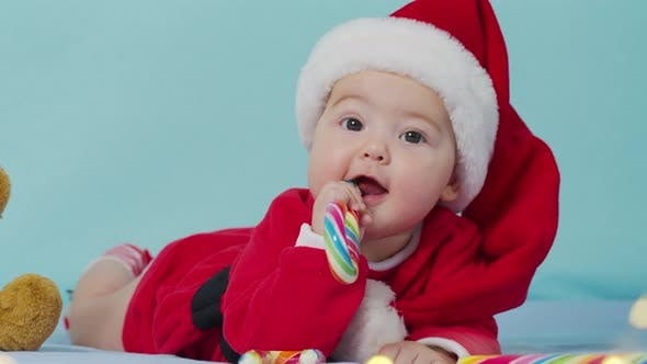 Merry Christmas and Happy New Year, Childhood, Holidays Concept Close-up. 3 Month Old Newborn Baby