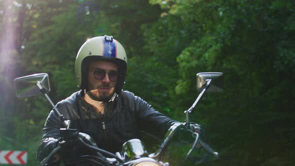Thumbnail for Young man riding a motorcycle