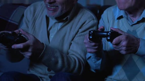 Happy Retired Men Playing Video Game at Night, Pension Leisure, Entertainment