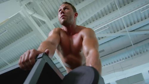 Topless Man Doing Dumbbell Rows
