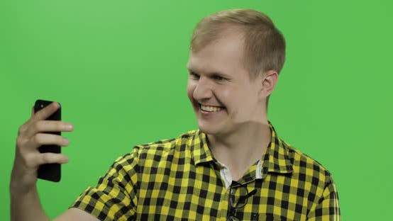 Thumbnail for Caucasian Young Man in Yellow Shirt Using Mobile Phone for Video Call