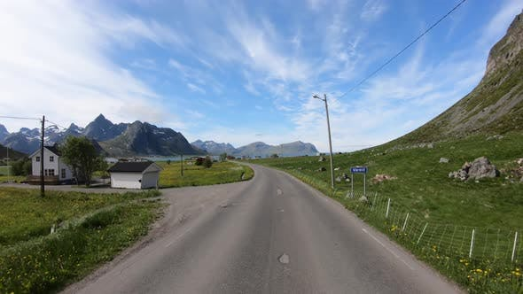 Vehicle Pointofview Driving a Car on a Road in Norway