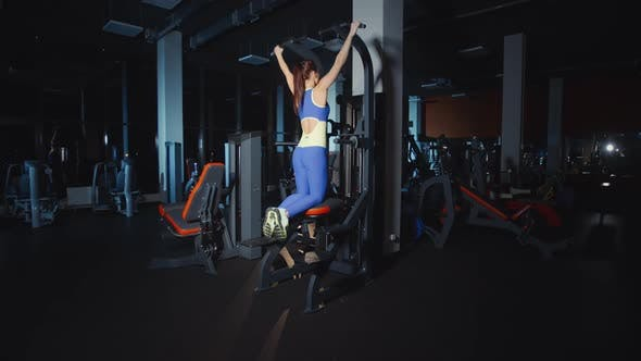 Thumbnail for Woman Doing Pull Ups Training Hands and Shoulders on Weights Lifting Machine Work Out