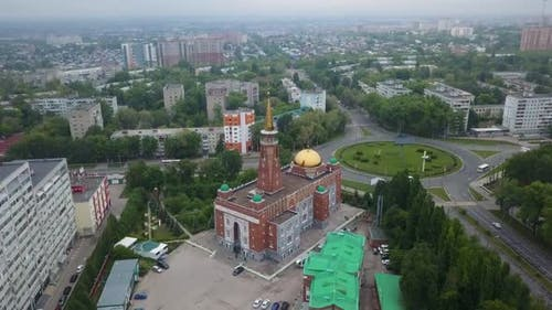 Aerial View of Modern Cityscape with Mosque at Summer Day, Eid al-Fitr