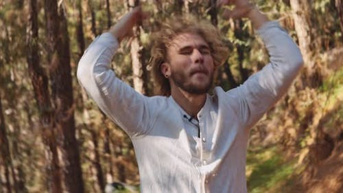 Man Raving And Dancing In Forest