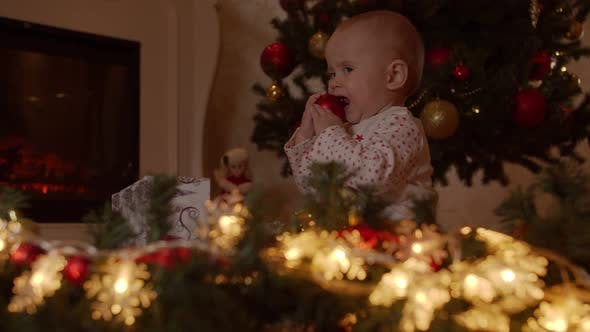 Thumbnail for Little Child Waiting for Christmas Sits By the Christmas Tree