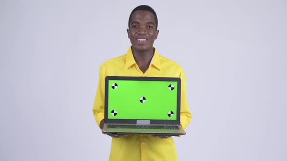 Thumbnail for Young Happy African Businessman Showing Laptop and Looking Surprised