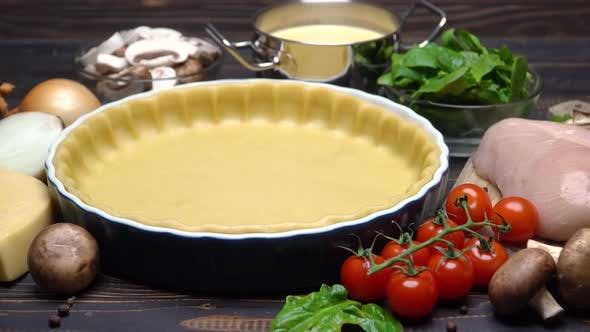 Cover Image for Shortbread Dough for Baking Quiche Tart and Ingredients in Baking Form
