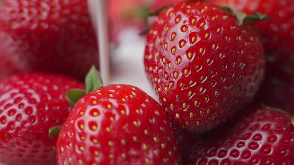 Pouring Yogurt Into Strawberries in Slow Motion.