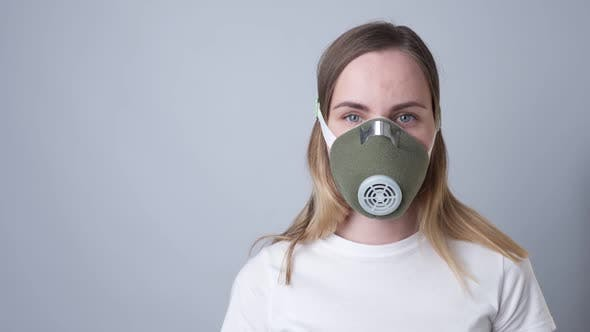Cover Image for Woman in a Respiratory Mask, Isolated on a Gray Background