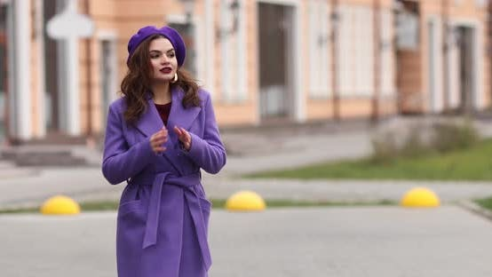 Thumbnail for Elegant Woman in Purple Beret and Coat Walking in the Street
