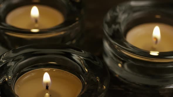 Thumbnail for Tea candles with flaming wicks on a wooden background - CANDLES 018