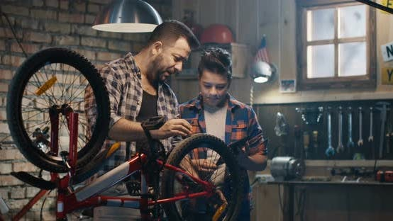 Thumbnail for Father and Son Talking About Bike Repair
