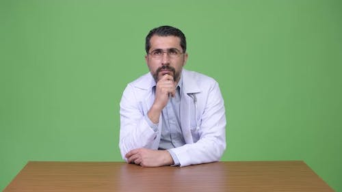 Handsome Persian Bearded Man Doctor Thinking