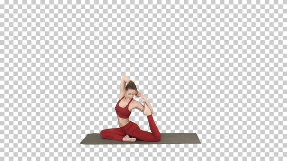 Thumbnail for Beautiful young woman wearing red sportswear doing yoga