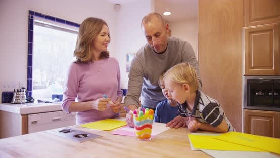Thumbnail for Lovely white family drawing together in the kitchen