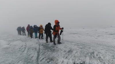 Mountaineering activity on the steep mountain slope