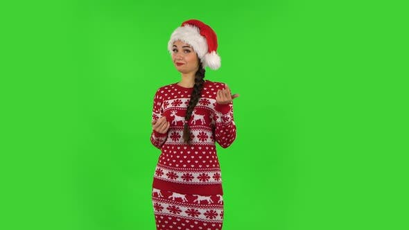 Thumbnail for Sweety Girl in Santa Claus Hat Is Coquettishly Showing Gesture Come Here. Green Screen