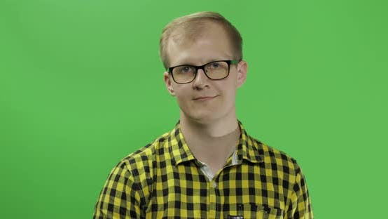 Thumbnail for Young Man in Yellow Shirt Turning His Head and Looking in the Camera