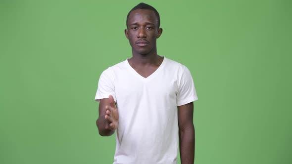 Young African Man Giving Handshake