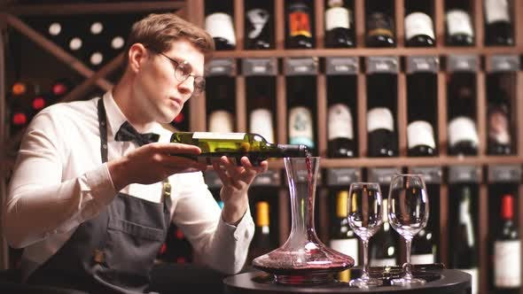Thumbnail for Skilled Sommelier Pouring Wine From Decanter Ino Wine Glass.