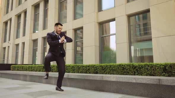 Thumbnail for Success and Achievement - Happy Businessman Cheering Celebrating Looking at Cell Phone. Young Urban