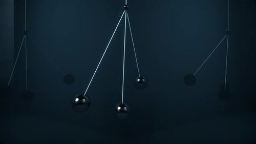 Metal Balls Swing in the Air Without Colliding