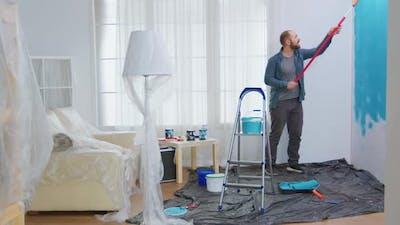 Man Renovating Apartment