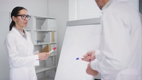 Thumbnail for Biomedical Scientists Discussing Work in Laboratory
