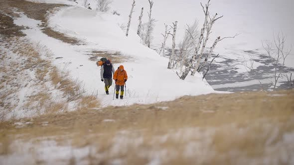 Thumbnail for a Team of Two Men Go on an Expedition. Difficult Conditions of the North, Each Step Is Dangerous and