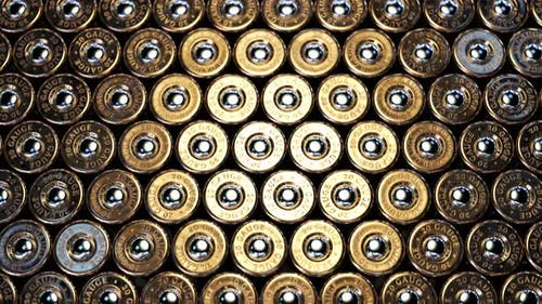 The endless stack of a rifle or machine gun ammunition standing one by one. 4KHD