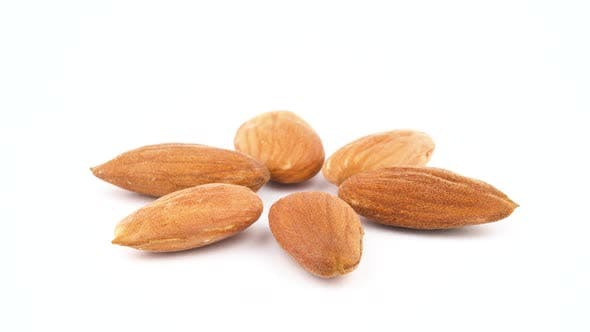 Thumbnail for Six Peeled Almonds. Slowly Rotating on the Turntable. Isolated on the White Background