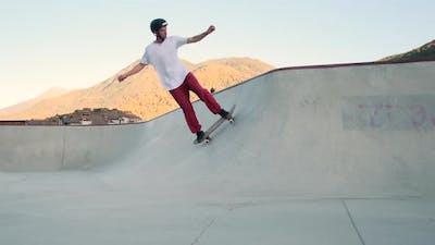 Skateboard Rider Sharpening His Skills in Bowl Ramp