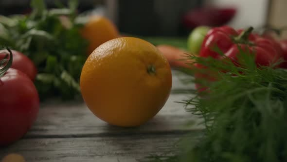 Thumbnail for Unrecognizable Person Rolling Orange Past Organic Vegetables