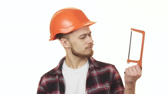 Thumbnail for Young Handyman Choosing Between Two Saws To Use