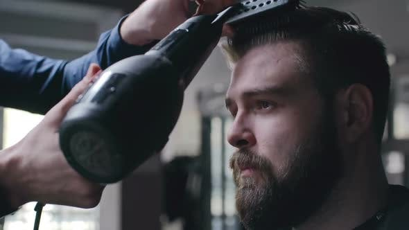 Thumbnail for Professional Barber Using Hair Dryer