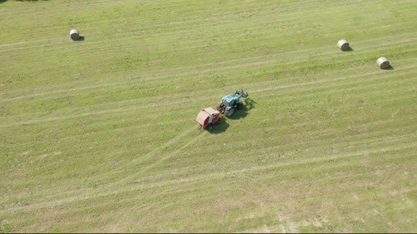 Thumbnail for Blue Tractor Hay Bales Field Aerial View