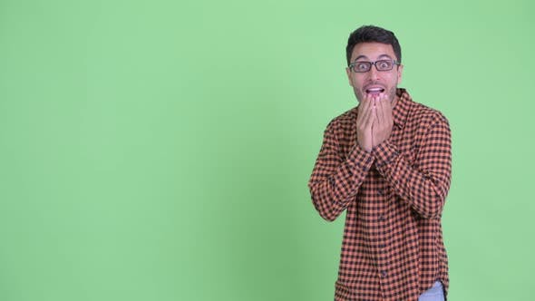 Thumbnail for Happy Young Hispanic Hipster Man Touching Something and Looking Surprised