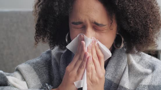 Thumbnail for Closeup of African American Girl Suffering From Runny Nose Disease Flu Virus Symptoms Woman Covered