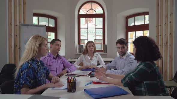 Thumbnail for Staff Discussing Project in the Morning