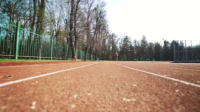 Athlete Woman Starting Running on Running Track