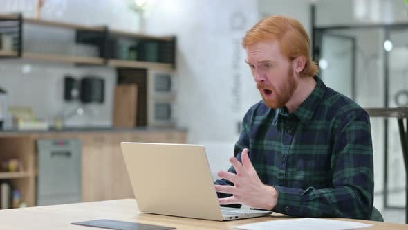 Beard Redhead Man Reacting To Loss on Laptop in Cafe, Failure