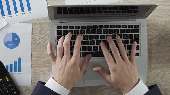 Entrepreneur Typing on Laptop Dollar Bills Lying Aside Firm Profit Calculation