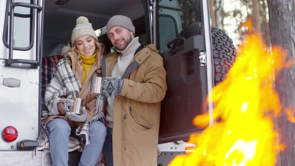 Thumbnail for Couple at Bonfire in Forest