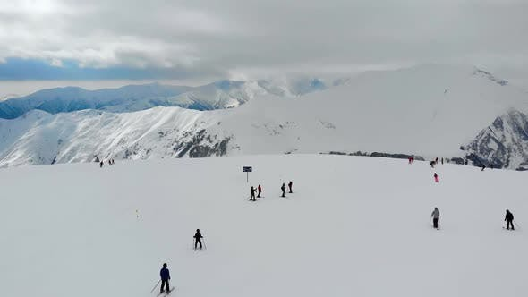 Thumbnail for Tourists Riding From Snowy Hill in Mountains.