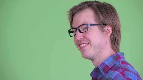 Thumbnail for Closeup Profile View of Happy Young Hipster Man Looking at Camera