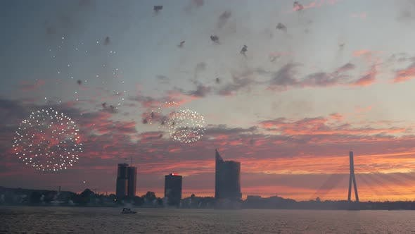 Cover Image for Fireworks during sunset in Riga with the Vanšu Bridge in Latvia