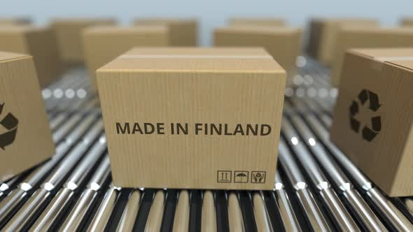 Boxes with MADE IN FINLAND Text on Conveyor