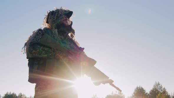 Thumbnail for Armed Man in Military Uniform. It Should Be Against the Sky, the Sun Is Shining